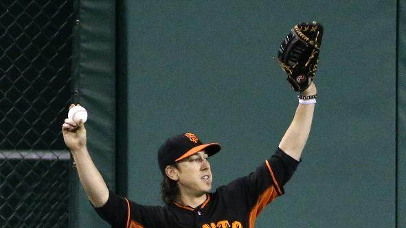 San Francisco Giants pitcher Tim Lincecum shags fly balls in the outfield at PNC Park in Pittsburgh during a  team workout Tuesday, Sept. 30, 2014.The Giants face the Pittsburgh Pirates in Wednesday night's  National League wild card baseball game in Pittsburgh. (AP Photo/Gene J. Puskar)