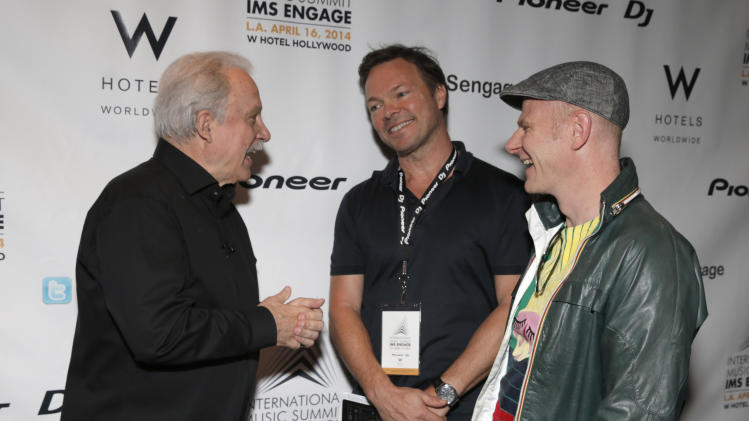 From left, Giorgio Moroder, Pete Tong and Junkie XL arrive at the International Music Summit - IMS Engage at W Hollywood, on Wednesday, April 16, 2014, in Los Angeles. (Photo by Todd Williamson/Invision for W Hotels Worldwide/AP Images)