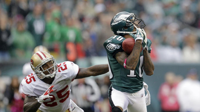 Philadelphia Eagles wide receiver DeSean Jackson (10) catches a pass as he is covered by San Francisco 49ers cornerback Tarell Brown (25) in the second half of an NFL football game Sunday, Oct. 2, 2011 in Philadelphia. (AP Photo/Julio Cortez)