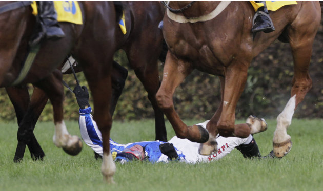 Czech rider Sovka lays on ground after Big Taxis obstacle during 122nd Velka Pardubicka Steeplechase horse race in Pardubice