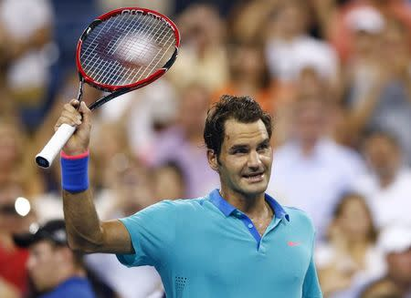 Roger Federer of Switzerland celebrates after defeating Marcel Granollers of Spain in men's singles play following match at 2014 U.S. Open tennis tournament in New York