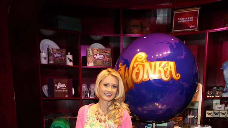 IMAGE DISTRIBUTED FOR WONKA - Holly Madison is seen with Wonka's Oompa Loompas at the new Wonka store at Sweet! Hollywood during the launch of the Wonka Inventing Room Collection, a decadent premium chocolate line, on Tuesday Nov. 13, 2012, in Los Angeles. (Photo by Casey Rodgers/Invision for WONKA/AP Images)