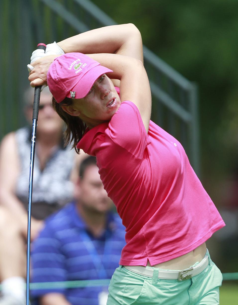 Karine Icher tees off on the first hole during the third round of the Mobile Bay LPGA Classic golf tournament, Saturday, April 28, 2012, in Mobile, Ala. (AP Photo/Press-Register, Bill Starling) MAGS OUT