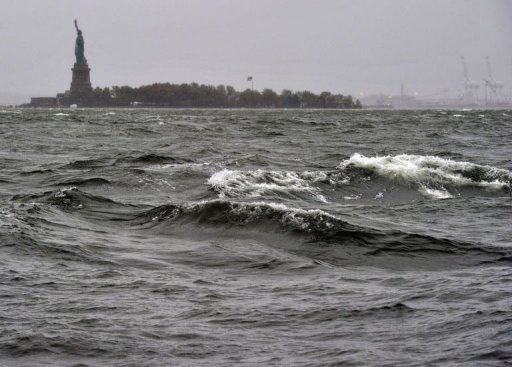 <p>High surf batters the Hudson River near the Statue of Liberty in New York. The storm's assault on the eastern United States is a major test of the key data and telecom networks that are needed to keep information flowing during such crises.</p>