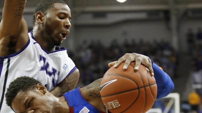 TCU forward Connell Crossland defends as Kansas guard Ben McLemore (23) drives to the basket during the first half of an NCAA college basketball game Wednesday, Feb. 6, 2013, in Fort Worth, Texas. (AP Photo/Sharon Ellman)