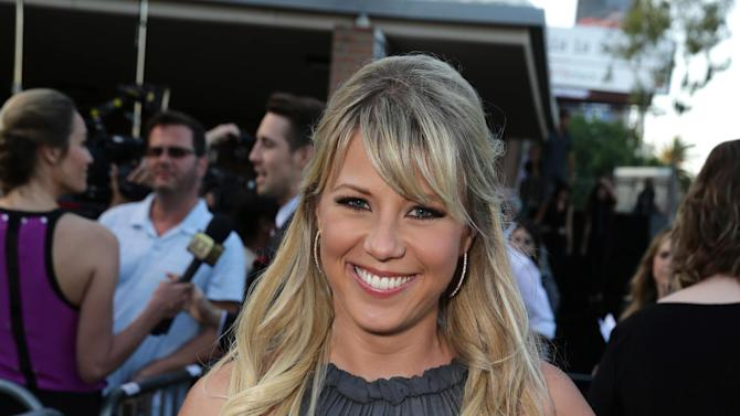 """Jodie Sweetin seen at the Los Angeles Premiere of New Line Cinema """"The Gallows"""" held at Hollywood High School on Tuesday, July 7, 2015. (Photo by Eric Charbonneau/Invision for Warner Bros./AP Images)"""