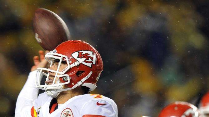 Kansas City Chiefs quarterback Matt Cassel (7) tries to pass as Pittsburgh Steelers inside linebacker Lawrence Timmons (94) pressures in the second quarter of an NFL football game, Monday, Nov. 12, 2012, in Pittsburgh. (AP Photo/Don Wright)