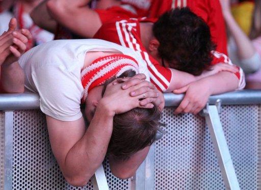 Fans of German soccer club FC Bayern Munich react during a public screening of the UEFA Champions League final