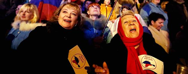A crowd gathers around Lenin Square in the Crimean capital to celebrate the early results of the referendum. (Reuters)