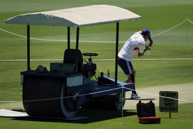 England's Pietersen practices some batting strokes while holding a water bottle on the pitch at the WACA ground in Perth