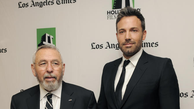 """Ben Affleck, right, a cast member and director of the film """"Argo,"""" poses with former C.I.A. agent Tony Mendez, whom he portrays in the film, backstage at the 16th Annual Hollywood Film Awards Gala on Monday, Oct. 22, 2012, in Beverly Hills, Calif. (Photo by Chris Pizzello/Invision/AP)"""