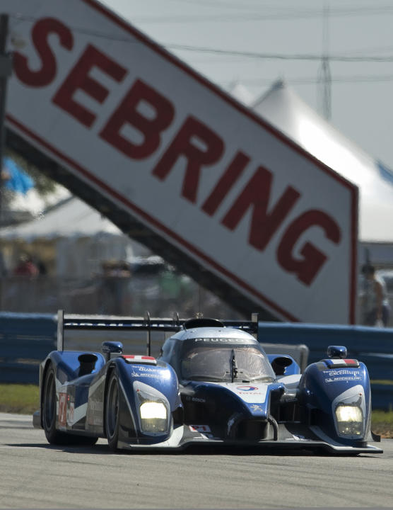Peugeot Sport Total's Alexander Wurz, of Austria, brakes the Peugeot 908 (7) on the approach to Turn 7 during the 59th annual American Le Mans Series 12 Hours of Sebring auto race at the Sebring Inter