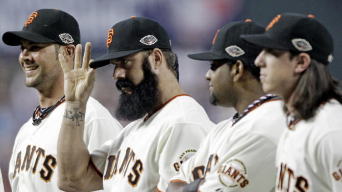 National League's Brian Wilson of the San Francisco Giants acknowledges the crowd during introductions for the MLB All-Star baseball game Tuesday, July 12, 2011, in Phoenix. (AP Photo/David J. Phillip)