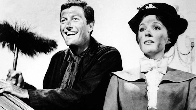 "FILE - In this undated file photo, Dick Van Dyke and Julie Andrews watch in amusement as a band of dancing chimney sweeps turn the house topsy-turvy in Walt Disney's musical-fantasy, ""Mary Poppins."" (AP Photo, File)"