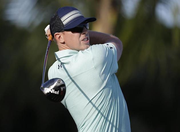 Hunter Mahan hits from the 16th tee during the third round of the Cadillac Championship golf tournament on Saturday, March 8, 2014, in Doral, Fla