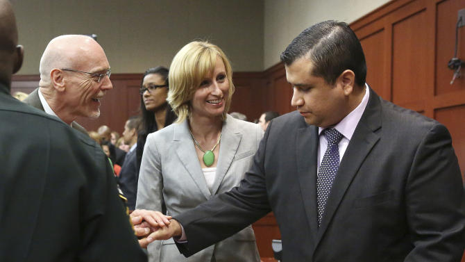 George Zimmerman, right, is congratulated by his defense team after being found not guilty during Zimmerman's trial in Seminole Circuit Court in Sanford, Fla. on Saturday, July 13, 2013. Jurors found Zimmerman not guilty of second-degree murder in the fatal shooting of 17-year-old Trayvon Martin in Sanford, Fla. The six-member, all-woman jury deliberated for more than 15 hours over two days before reaching their decision Saturday night. (AP Photo/Gary W. Green, Pool)