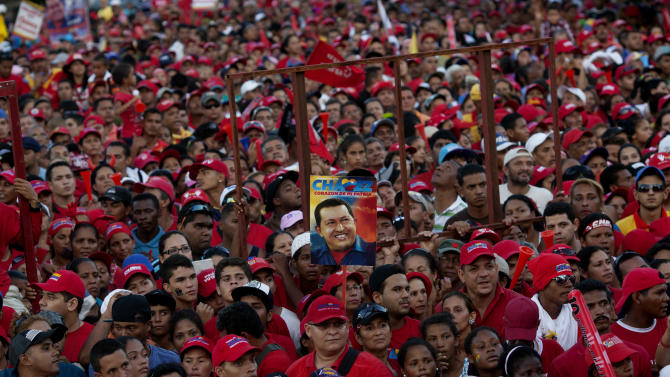 Supporters of Venezuela's President Hugo Chavez attend a campaign rally in Valencia, Venezuela, Wednesday, Oct. 3, 2012. Chavez is running for re-election against opposition candidate Henrique Capriles in presidential elections on Oct . 7. (AP Photo/Rodrigo Abd)
