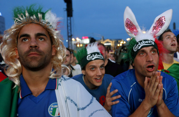 Italian soccer fans react while watching the Euro 2012 soccer championship quarterfinal match between England and Italy in a fan zone in Warsaw, Poland, Sunday, June 24, 2012. (AP Photo/Czarek Sokolowski)