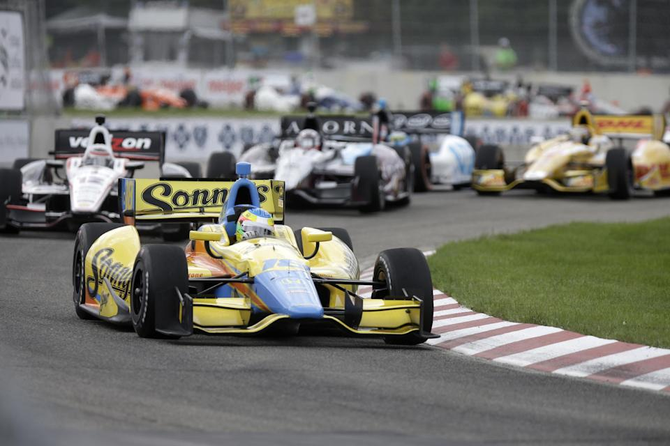 Mike Conway leads through the second turn during the IndyCar Detroit Grand Prix auto race on Belle Isle in Detroit, Sunday, June 2, 2013. (AP Photo/Carlos Osorio)