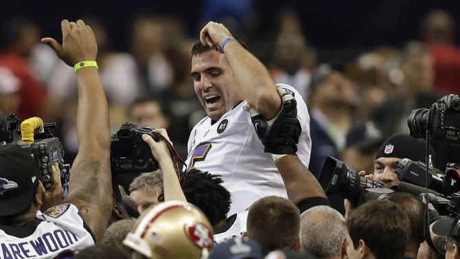 FILE - In this Feb. 3, 2013, file photo, Baltimore Ravens quarterback Joe Flacco is lifted into the air by teammates after defeating the San Francisco 49ers 34-31 in the NFL Super Bowl XLVII football game in New Orleans. A person with knowledge of the deal tells The Associated Press that Flacco has agreed on a new contract with the Ravens. The person spoke on condition of anonymity on Friday, March 1, 2013, because the agreement has not officially been announced. Terms of the deal were not immediately available.(AP Photo/Bill Haber, File)