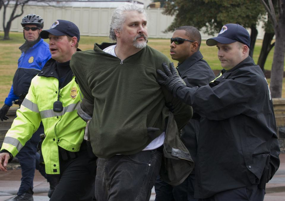 "Capitol Hill Police arrest William Griffin as ""occupy Congress"" protesters are moved out of a restricted area on the West Lawn on Capitol Hill in Washington, Tuesday, Jan. 17, 2012.  (AP Photo/J. Scott Applewhite)"