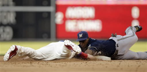Lucroy, Peralta help Brewers top Phillies 4-3