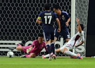 Venezuela's forward Nicolas Fedor (R) scores past Japanese goalie Eiji Kawashima (L) during an internatinal friendly football match between Jin Sapporo, Japan's northern island of Hokkaido. Japan and Venezuela drew 1-1