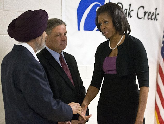First lady Michelle Obama greets  Sikh temple secretary of the board of trustees Kulwant Singh Dhaliwal, left, and Oak Creek, Wis. Mayor Stephen Scaffidi, before talking to victims of the August 5th s