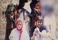 Swiss couple Olivier David Och (R) and Daniela Widmer are shown in a Fata Research Center photo following their abduction in Pakistan. The Pakistani Taliban have released the Swiss hostages who were kidnapped more than eight months ago while travelling through the country's volatile southwest