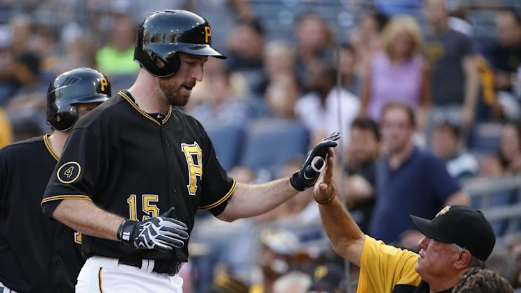 Pittsburgh Pirates' Ike Davis (15) celebrates as he returns to the dugout after hitting a solo home run off Los Angeles Dodgers starting pitcher Josh Beckett during the second inning of a baseball game in Pittsburgh Tuesday, July 22, 2014. The Pirates won 12-7. (AP Photo)