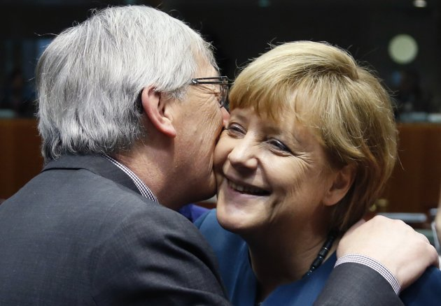 Luxembourg's PM Juncker greets Germany's Chancellor Merkel during a European Union leaders summit in Brussels