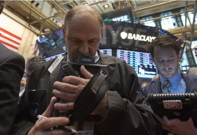 Trader Randy Biller, left, works on the floor of the New York Stock Exchange Thursday, May 23, 2013. A global stock market slump is continuing on Wall Street as traders worry about how committed the F