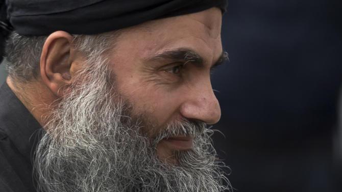 FILE - This is a Tuesday, Nov. 13, 2012 file photo of Abu Qatada as he arrives back at his residence in London after being freed from prison. The British government has lost its appeal  Wednesday March 27, 2013, against an immigration tribunal's decision allowing a radical Muslim cleric Abu Qatada to remain in Britain. Britain wants to deport Abu Qatada to Jordan, where he was convicted in absentia for terror plots in 1999 and 2000.  (AP Photo/Matt Dunham, File)