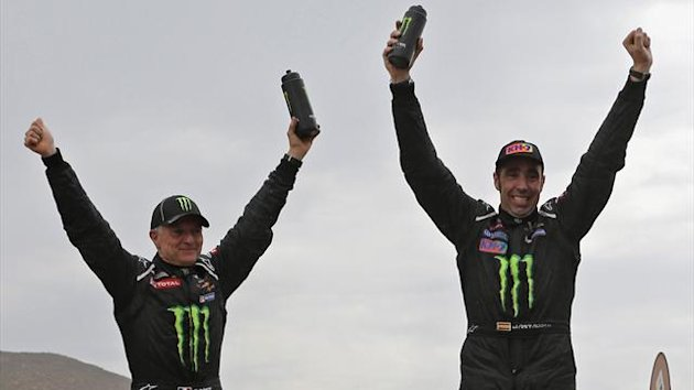 Nani Roma (R) of Spain and his co-driver Michel Perin of France celebrate on their Mini after winning the sixth South American edition of the Dakar Rally (Reuters)