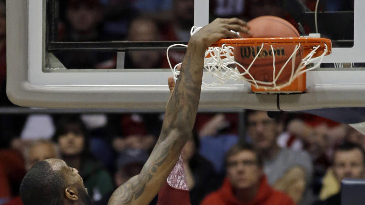 North Carolina State forward C.J. Leslie (5) dunks against Temple forward Anthony Lee (3) during the first half of a second-round game at the NCAA college basketball tournament, Friday, March 22, 2013, in Dayton, Ohio. (AP Photo/Al Behrman)
