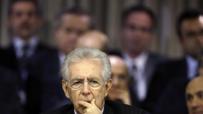 Italian Premier Mario Monti delivers his speech at the Foreign Ministry for the Italian Ambassadors conference in Rome, Friday, Dec. 21, 2012. Monti pledged to resign as soon as the budget law is passed after Silvio Berlusconi yanked support for his government, accelerating national elections now expected in February. The budget law was approved Friday afternoon. (AP Photo/Gregorio Borgia)