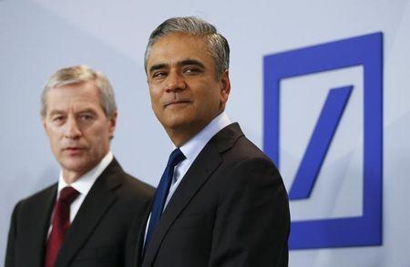 Jain and Fitschen, co-CEOs of Deutsche Bank, arrive for a news conference in Frankfurt