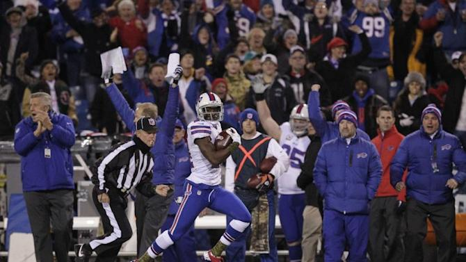 Buffalo Bills cornerback Leodis McKelvin (21) runs for a touchdwon on a punt return during the first half of an NFL football game against the Miami Dolphins, Thursday, Nov. 15, 2012, in Orchard Park, N.Y. (AP Photo/Bill Wippert)