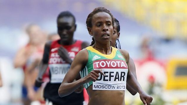 Meseret Defar of Ethiopia crosses the finish line to win her women's 5,000 metres heat during the IAAF World Athletics Championships at the Luzhniki stadium in Moscow August 14, 2013 (Reuters)