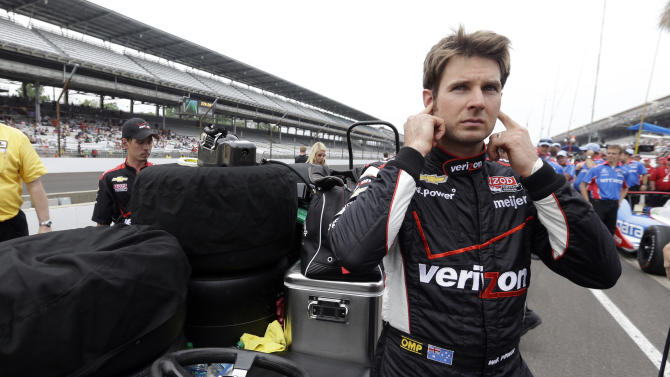Will Power, of Australia, covers his ear as he waits to be interview on the public address system following his qualification run on the first day of qualifications for the Indianapolis 500 auto race at the Indianapolis Motor Speedway in Indianapolis, Saturday, May 18, 2013. (AP Photo/Darron Cummings)