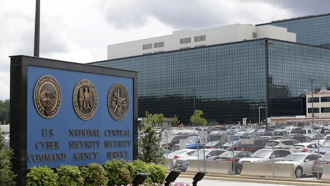 FILE - This Thursday, June 6, 2013 file photo shows the National Security Administration (NSA) campus in Fort Meade, Md. When Edward Snowden - the 29-year-old intelligence contractor whose leak of top-secret documents has exposed sweeping government surveillance programs - went to Arundel High School, the agency regularly sent employees from its nearby black-glass headquarters to tutor struggling math students. (AP Photo/Patrick Semansky)