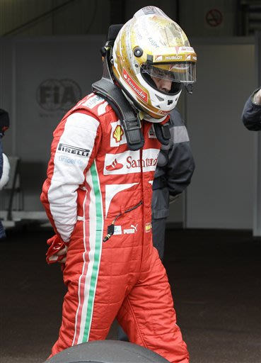 Ferrari driver Fernando Alonso, of Spain, walks after setting the sixth fastest time after qualifying practice session at the Monaco racetrack, in Monaco, Saturday, May 25, 2013. The formula one race