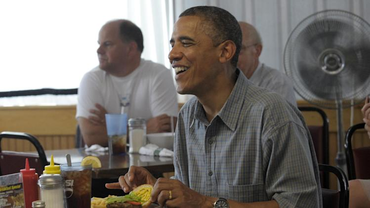 President Barack Obama eats lunch at the Kozy Corner diner in Oak Harbour, Ohio, Thursday, July 5, 2012. Obama is on a two-day bus trip through Ohio and Pennsylvania. (AP Photo/Susan Walsh)