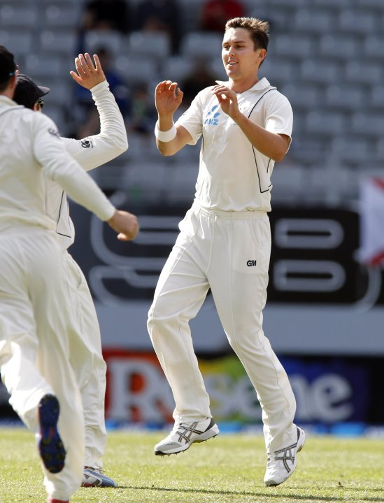 Trent Boult of New Zealand runs in to celebrate dismissing Alastair Cook on during day two of the final cricket test against England