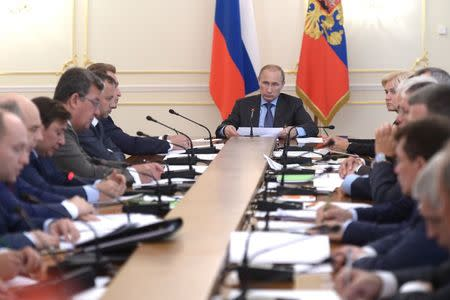 Russia's President Vladimir Putin chairs a government meeting at the Novo-Ogaryovo state residence outside Moscow