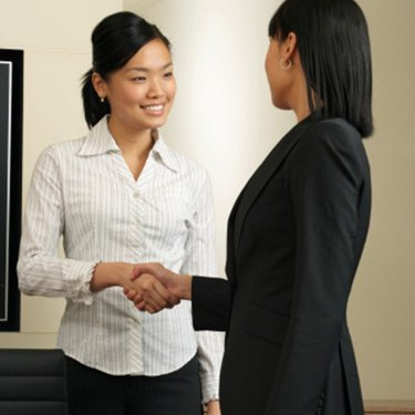 Asian-businesswoman-shaking-hands_web