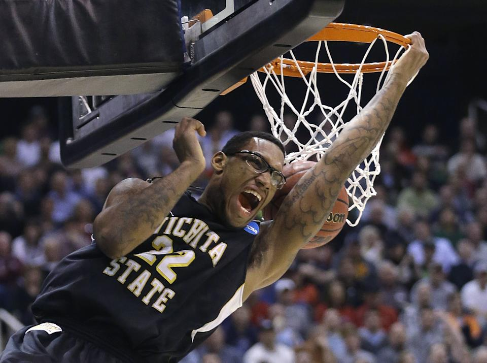 Wichita State's Carl Hall (22) dunks the ball in the first half during a third-round game against Gonzaga in the NCAA men's college basketball tournament in Salt Lake City Saturday, March 23, 2013. (AP Photo/Rick Bowmer)