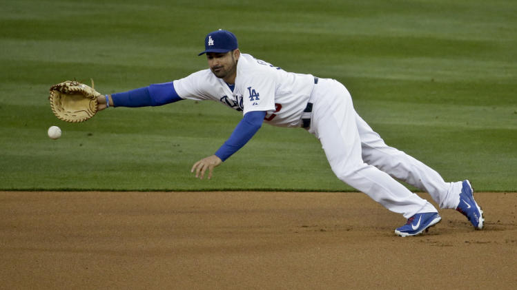 Los Angeles Dodgers first baseman Adrian Gonzalez can't get a glove on a single by Arizona Diamondbacks' Gerardo Parra during first inning of a baseball in Los Angeles, Friday, April 18, 2014. (AP Photo/Chris Carlson)