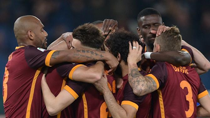 Roma's midfielder Diego Perotti (2ndL) celebrates with teammates after scoring during an Italian Serie A football against Sampdoria at the Olympic Stadium in Rome on February 7, 2016