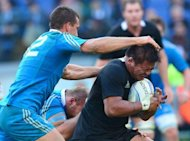 New Zealand All Blacks hooker Keven Mealamu (R) is tackled by Italy's centre Alberto Sgarbi during the International Rugby Union match in Rome. World champions the All Blacks beat Italy 42-10 in the one-off rugby union test